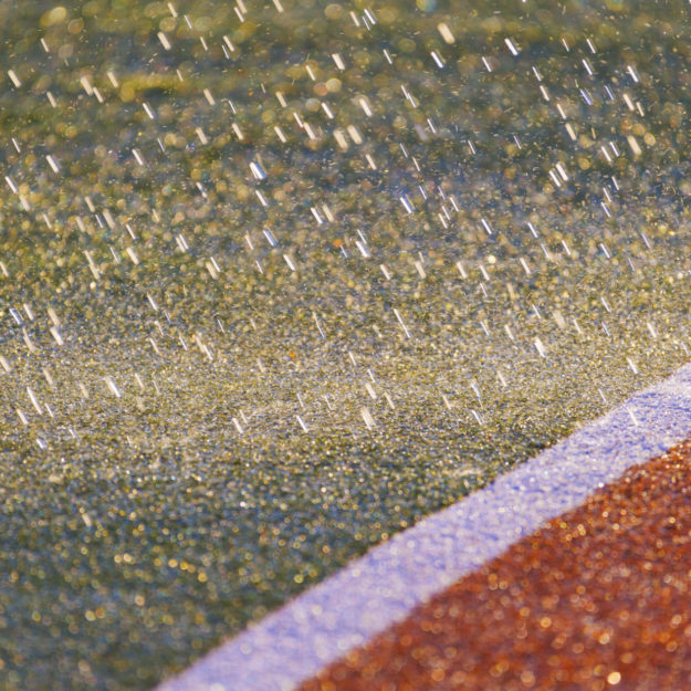 It rains .Texture of the herb cover sports field. Used in tennis, golf, baseball, field hockey, football, cricket, rugby.